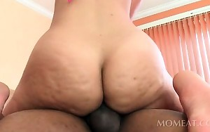 Horny chick humps dark shaft and takes jizz shot